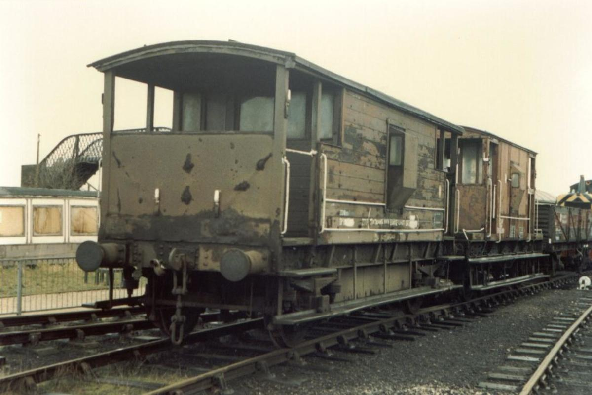 Nearest brakevan is ex-LMS in Departmental livery with standard (LNER design) behind on an engineer's train, screw couplings but shorn of vacuum pipe