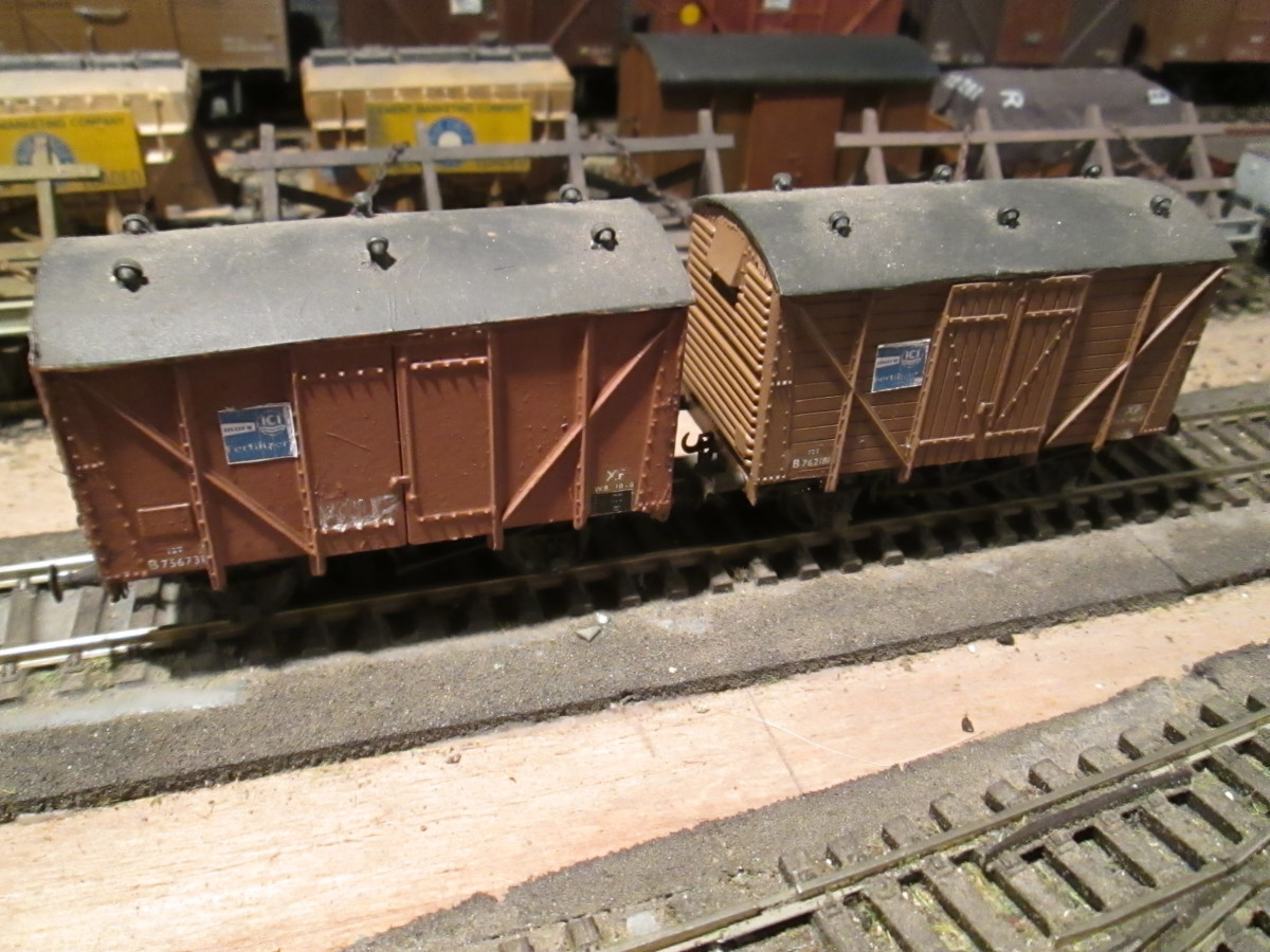A pair of early British Railways' vans, on the left a plywood-sided version of the planked one on the right (both Parkside kits with bought-in detailing)