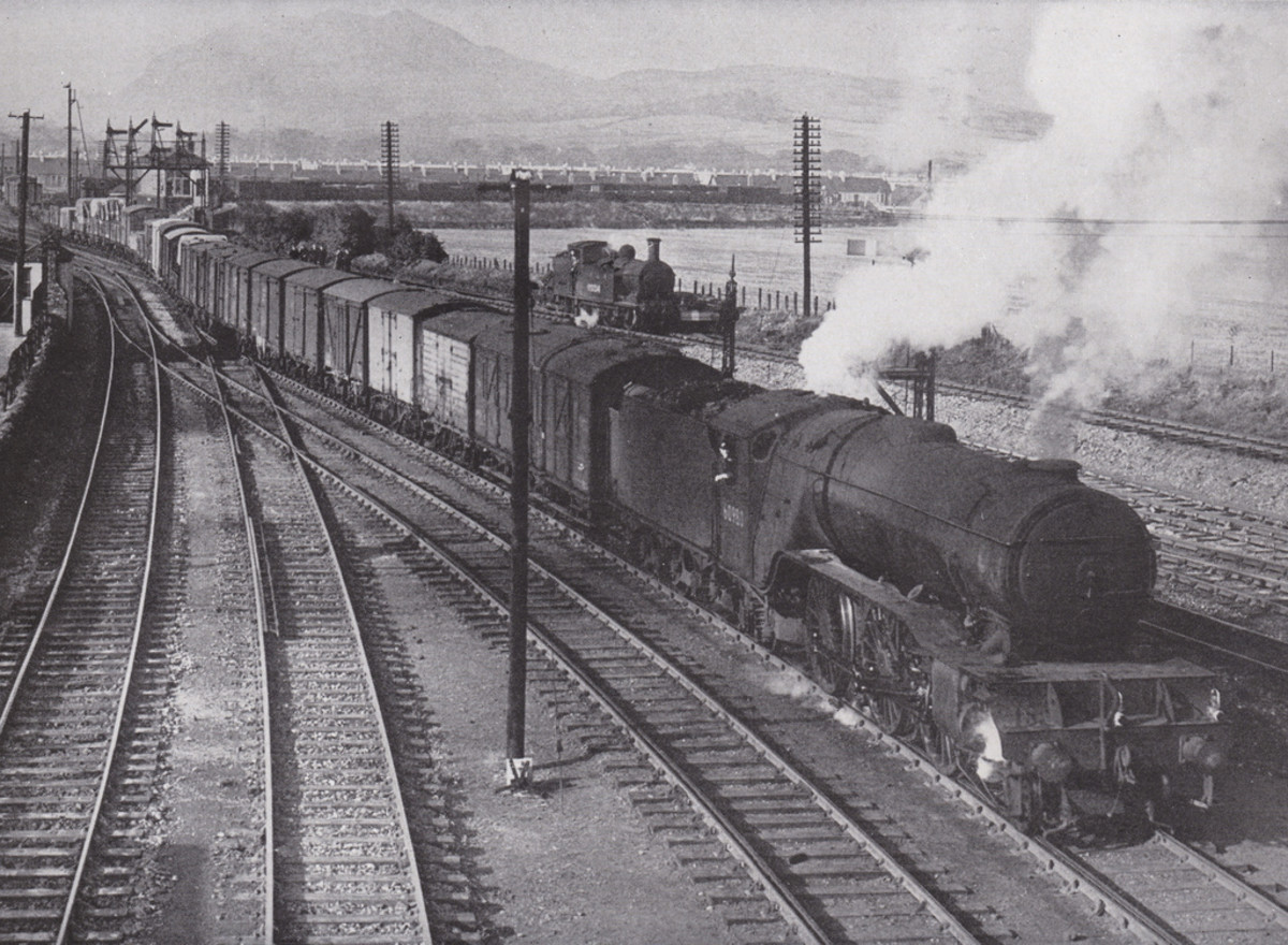Ex-LNE V2 2-6-2 with fully fitted Eastern Region freight at unknown location - vans at the head of the train, tarpaulined wagons towards the rear (same lamp code as above)