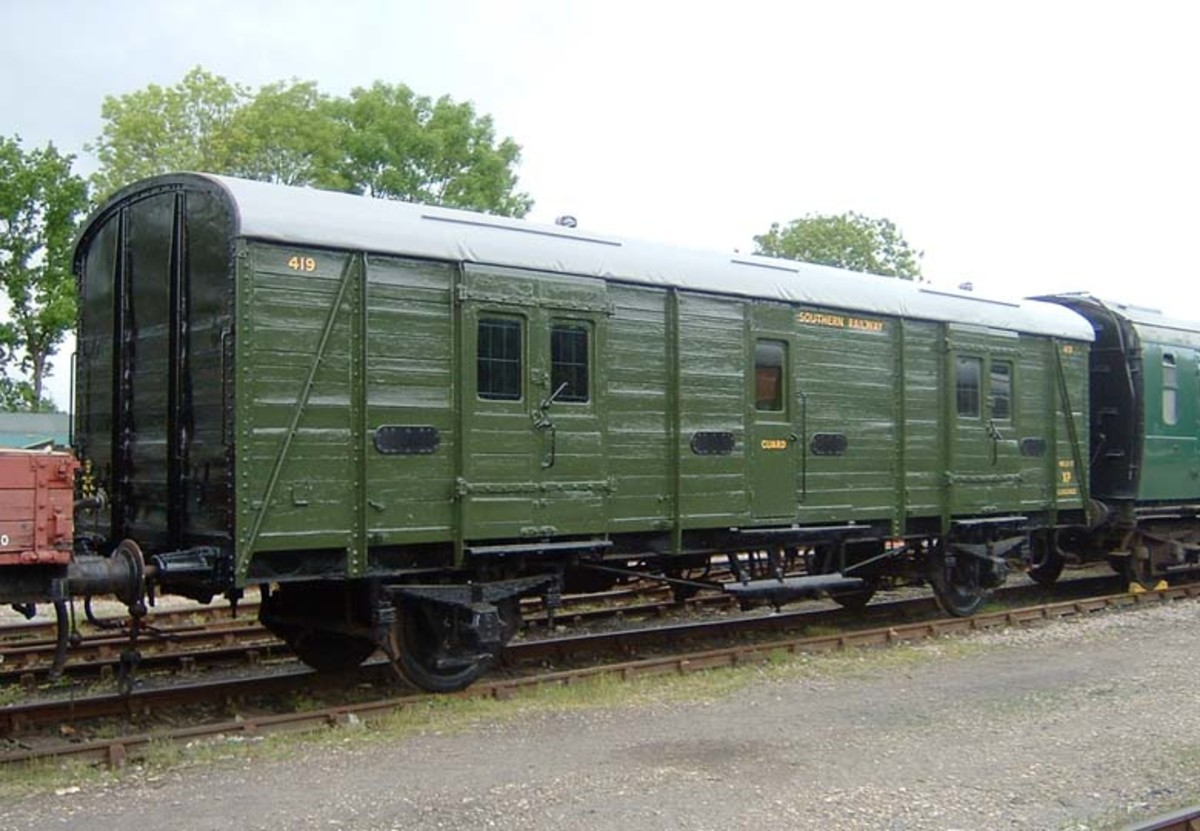 In Southern Railway green, preserved 4-wheeled Utility van stands on the Bluebell Railway in Sussex - often ran on passenger trains for passenger baggage on boat trains to the south coast,. some seen on parcels trains as far afield as Darlington