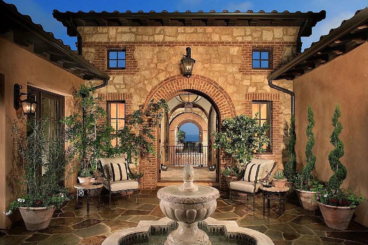 Mediterranean patios pergolas stucco terraces water for Mediterranean courtyard designs