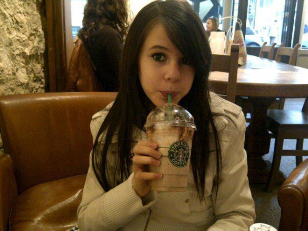 Marina Dalmas Drinking Starbuck's Coffee: Probably under age 13. See wall photos on her Facebook page (above).
