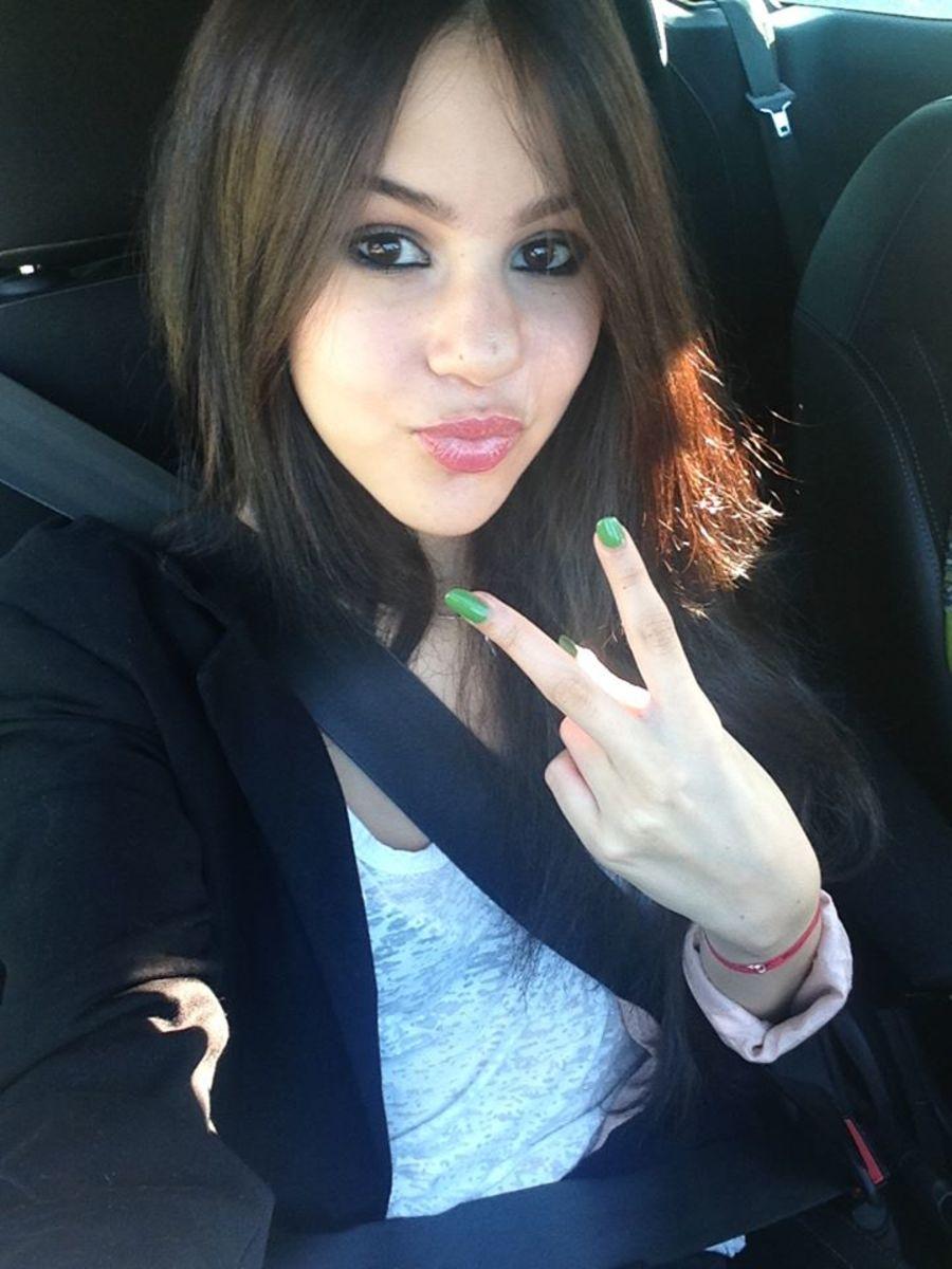 Marina Kaye in car.