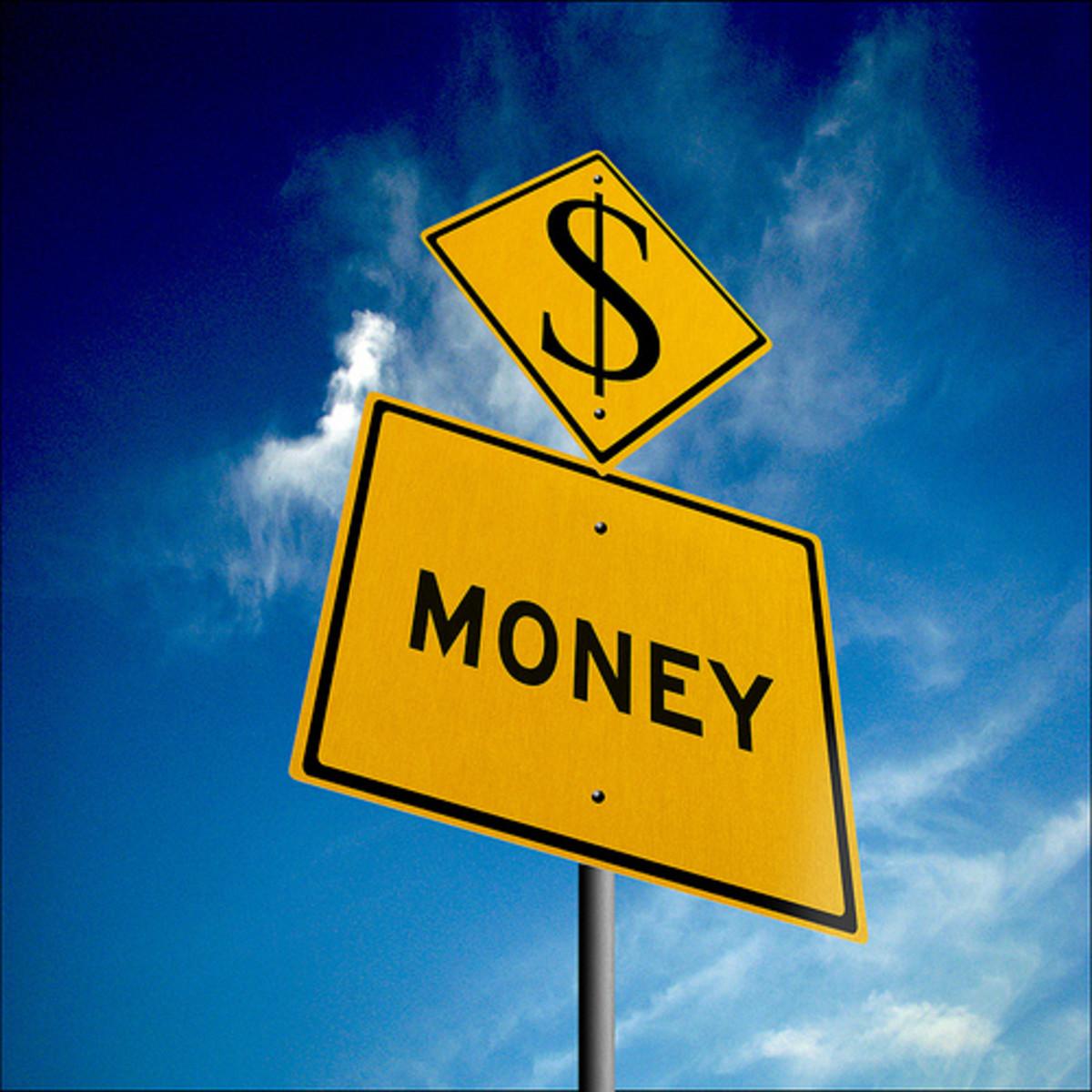 Money sign against sky