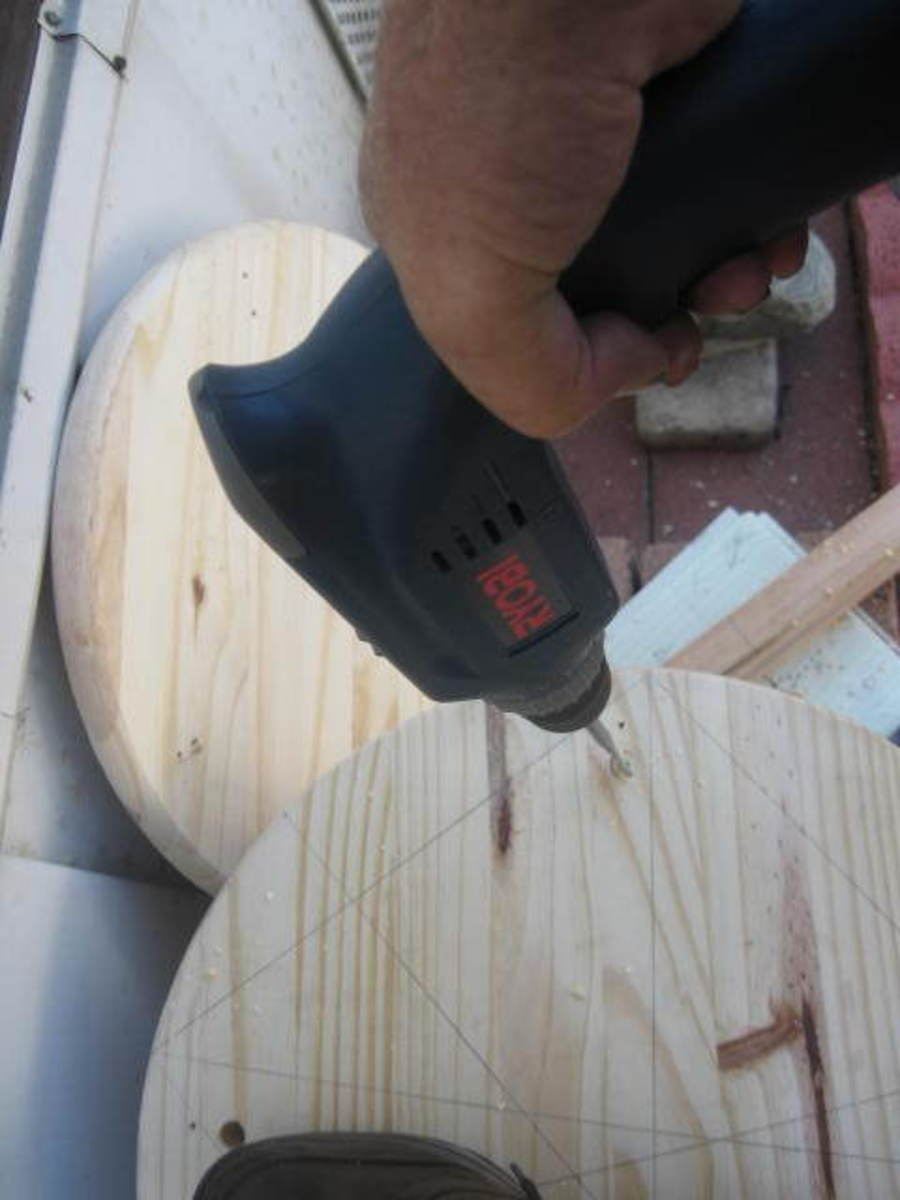 Be careful to maintain the power drill as straight as possible perpendicular to the board's surface.