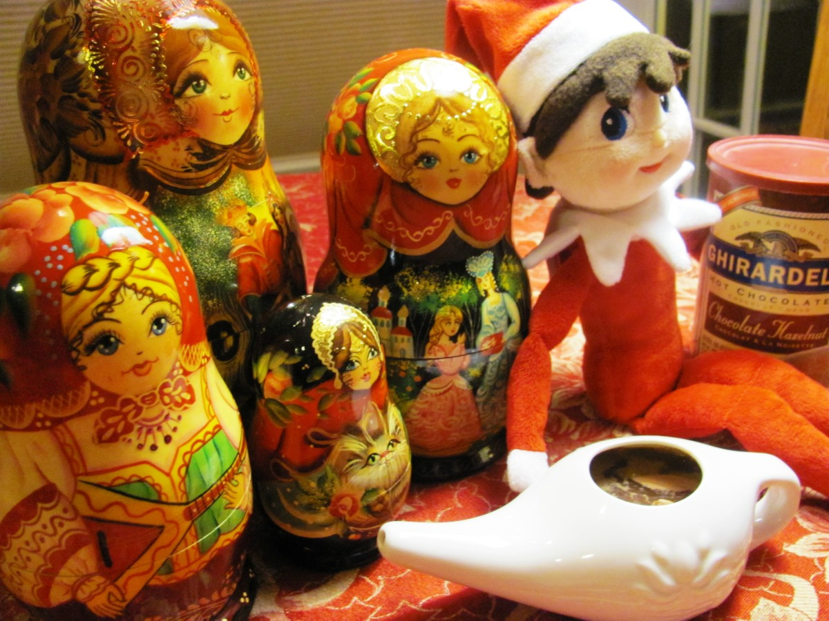 The elf served hot cocoa to his Russian doll friends out of a neti pot.  A neti pot is a device irrigation or nasal douche device.  Nice touch, Shelf Elf!