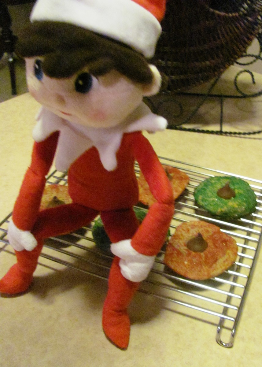 """Having a case of the """"Hershey squirts,"""" the elf decorated some Christmas cookies.  Yum!"""