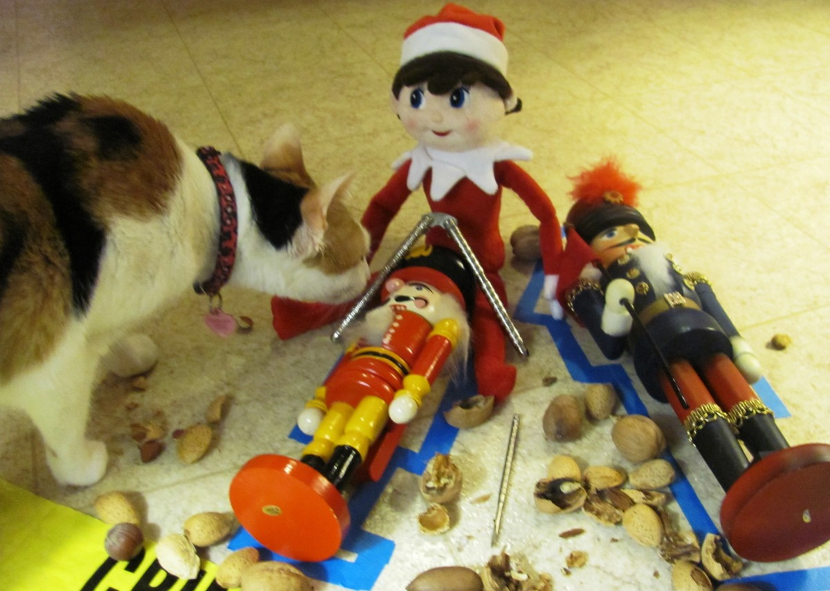 Stella, a North Pole Investigator, checks for signs of life among the nutcrackers before surveying the crime scene for damage.