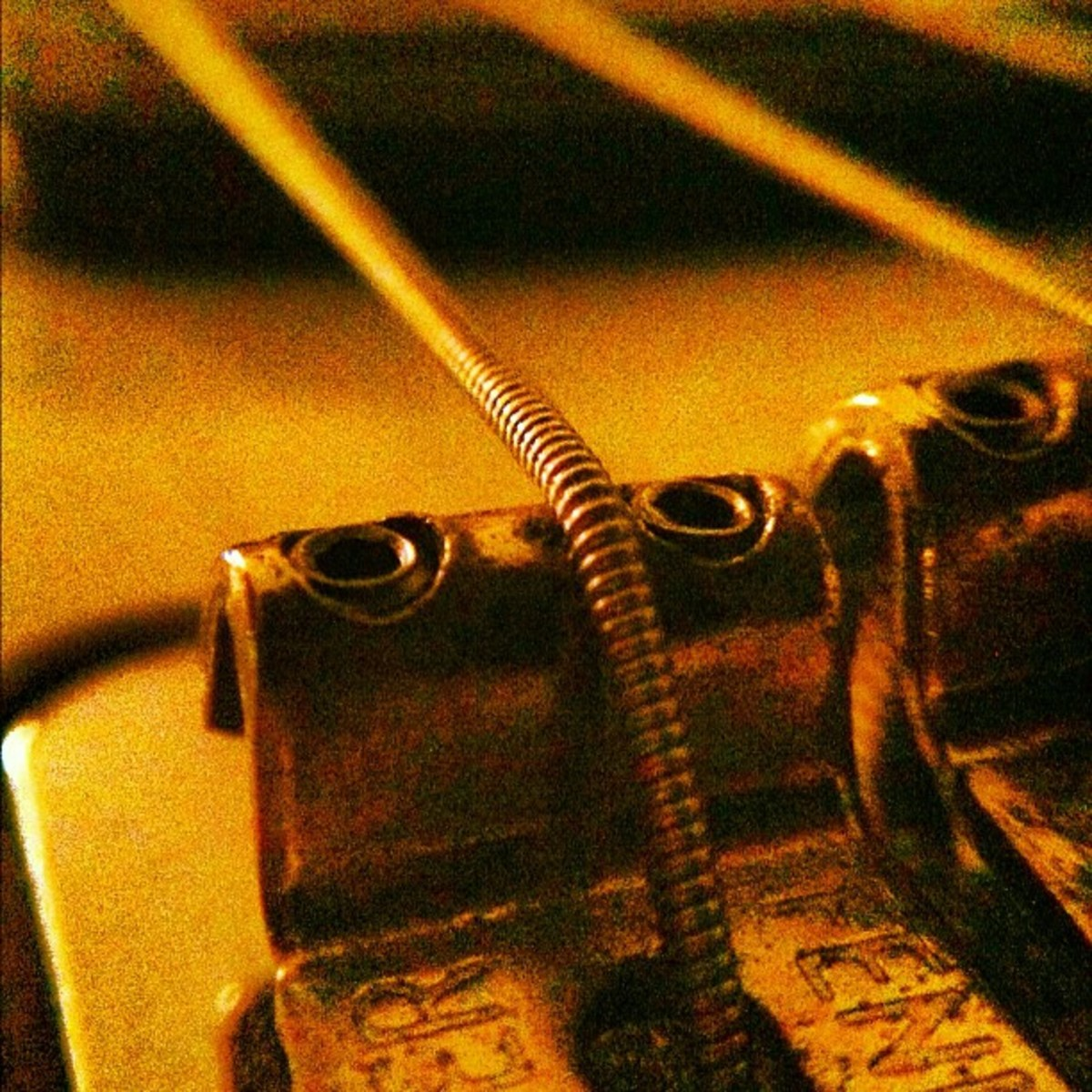 Closeup of (a part of) the bridge on a Fender Stratocaster