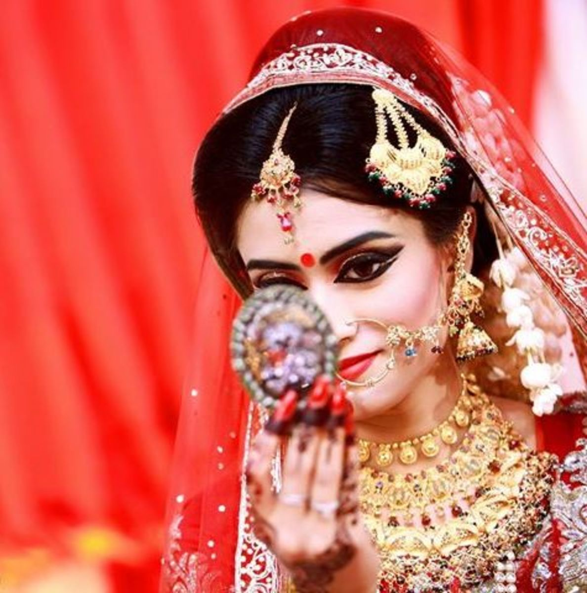 Topu's wife Naziba again in a red bridal saree and beautiful bridal makeup in Bangladesh.