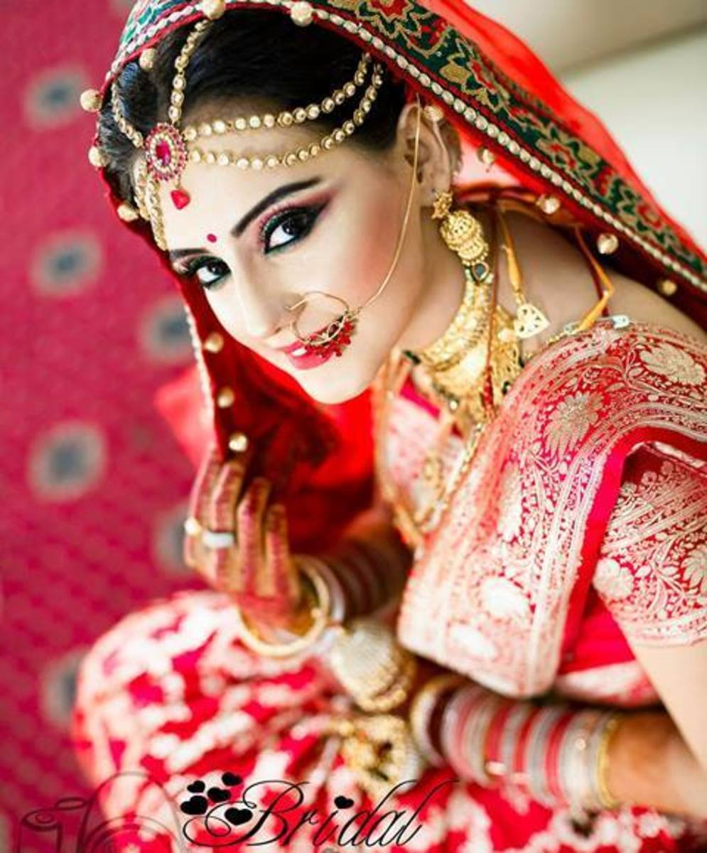 Bangladeshi bride in a lush red bridal katan saree.