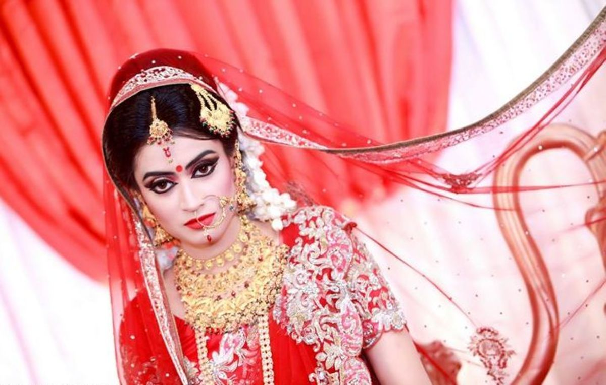 Naziba in red bridal attire.