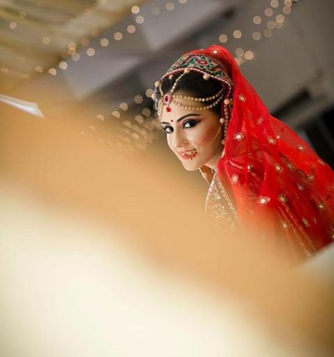 Bride posing at her wedding.