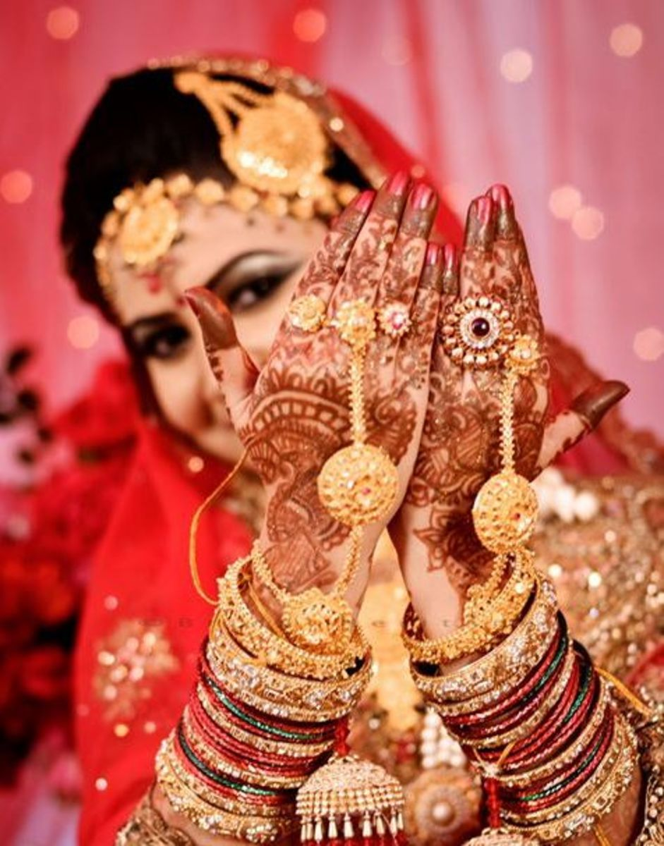 Bride showing off her henna or mehendi design.