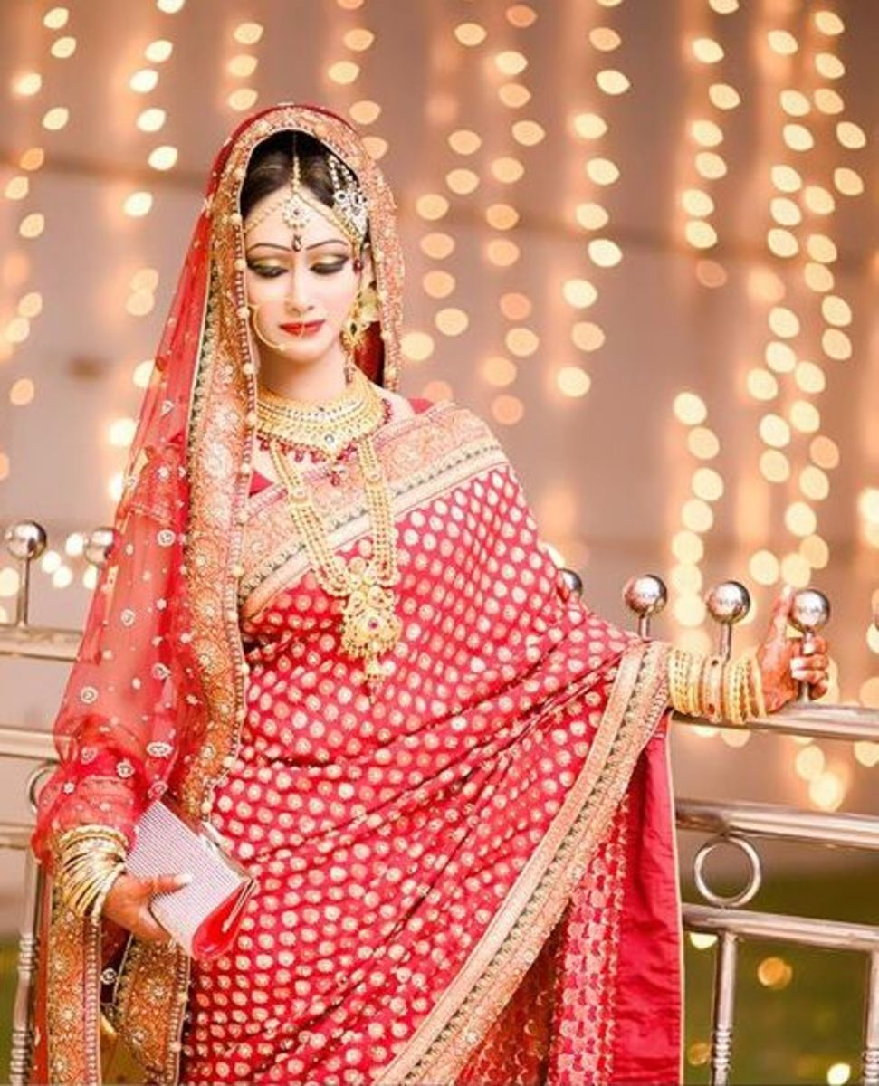 My best friend looking gorgeous on her wedding night wearing a red bridal katan from Vasaavi.