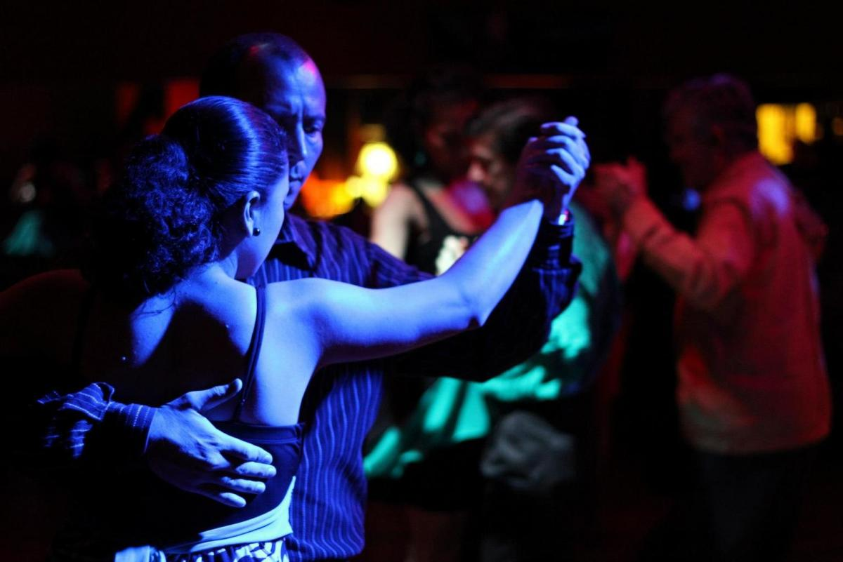 A couple dancing in a night club setting.