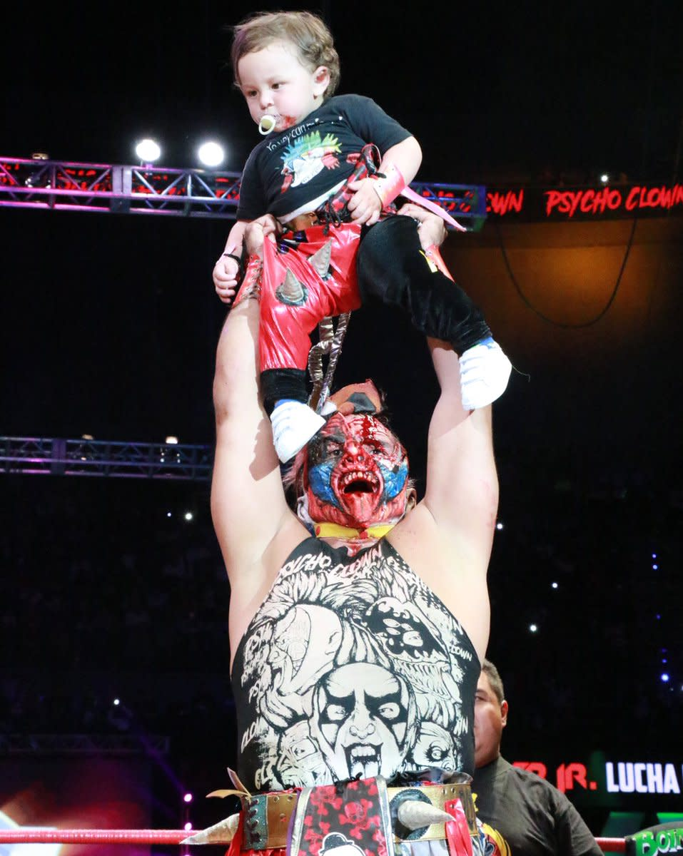 A bloody, triumphant Psycho Clown with his son