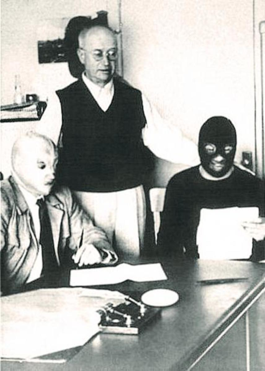 Salvador Lutteroth, El Santo and Black Shadow sign the contracts for their mask match