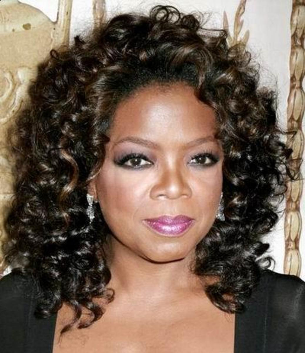 Oprah's medium-length curly hair