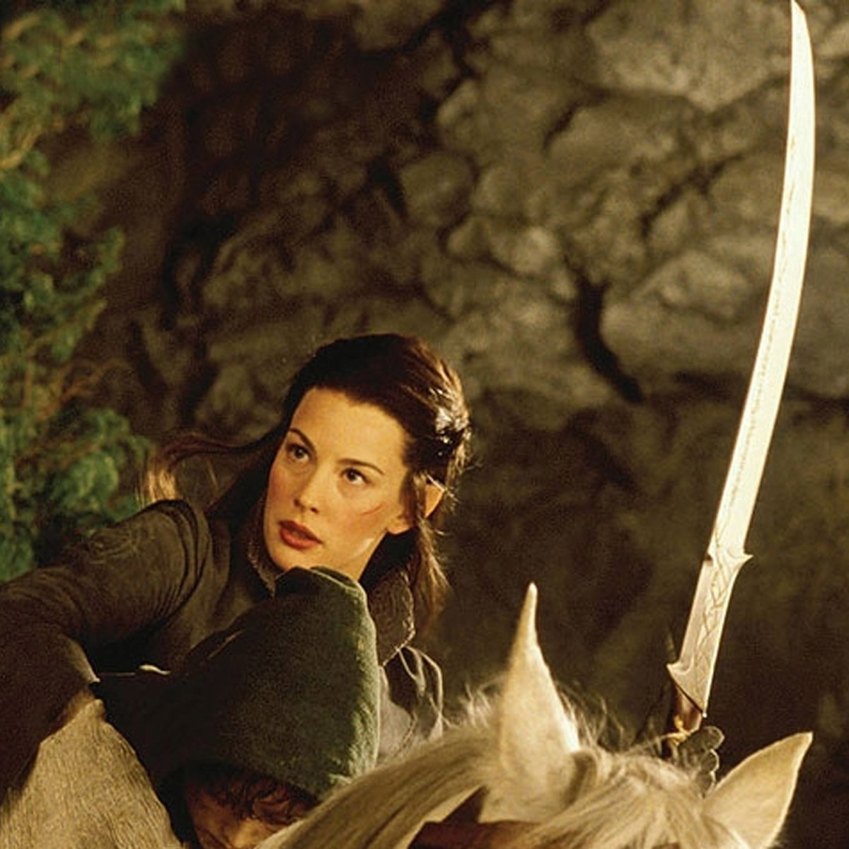 From New Line Cinema and Weta Works.  The arguably preferred image of Arwen: strong, armed, confidant, and determined in the face of the enemy.