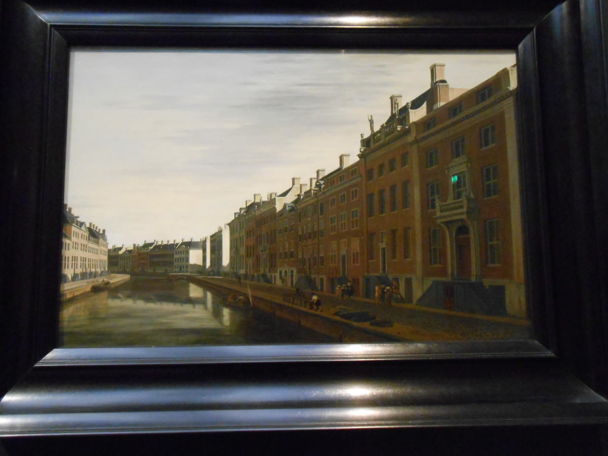 Painting of Old Amsterdam that is so clear in person it almost looks like a photograph.
