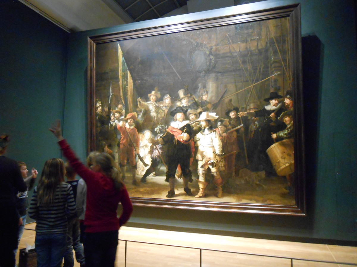 "Rembrandt's famous painting of, ""The Night Watch."" I included people in the picture so you can see how large the painting is."