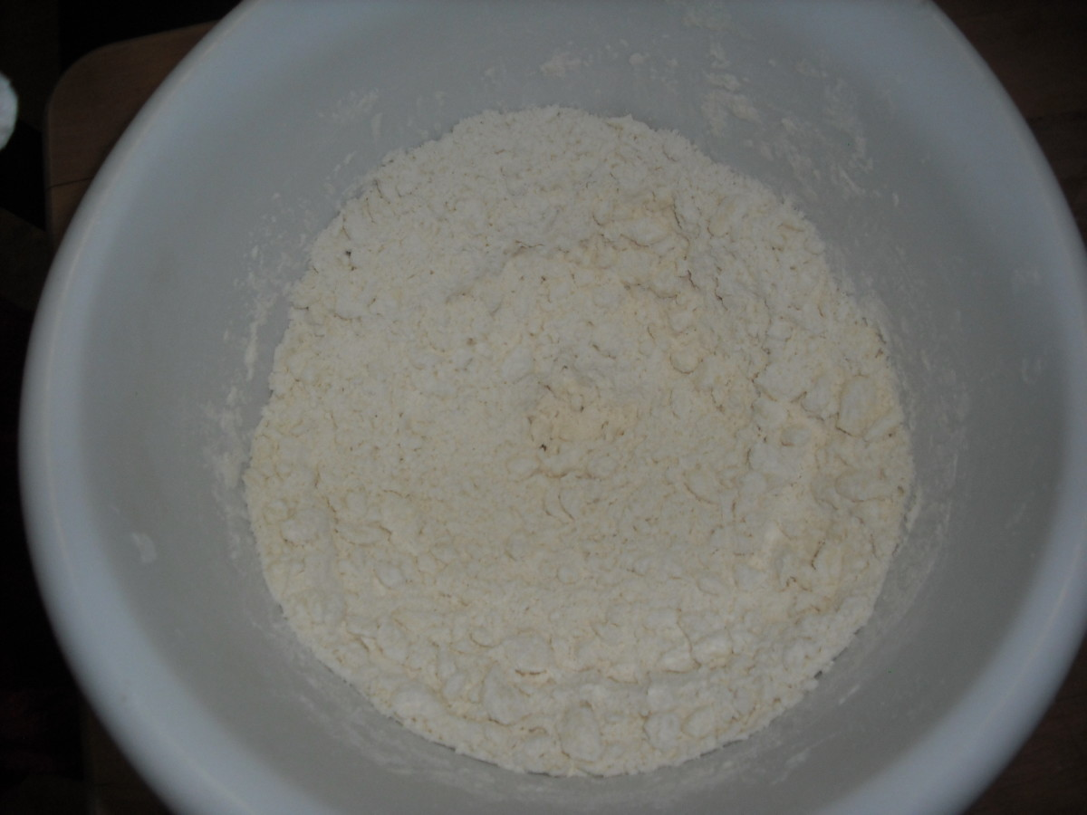 Cut in the butter and shortening until the mixture resembles breadcrumbs.