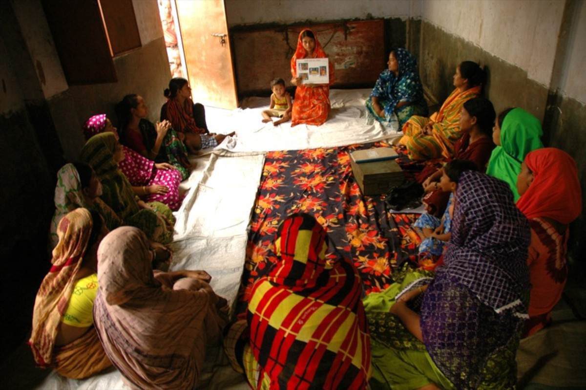 Women in Bangladesh attend a pre-natal education class in which they learn proper nutrition, hygiene, and health tips for their pregnancy.