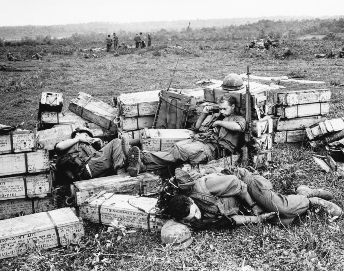 Soldiers sleeping on artillery stock in the Vietnam War.
