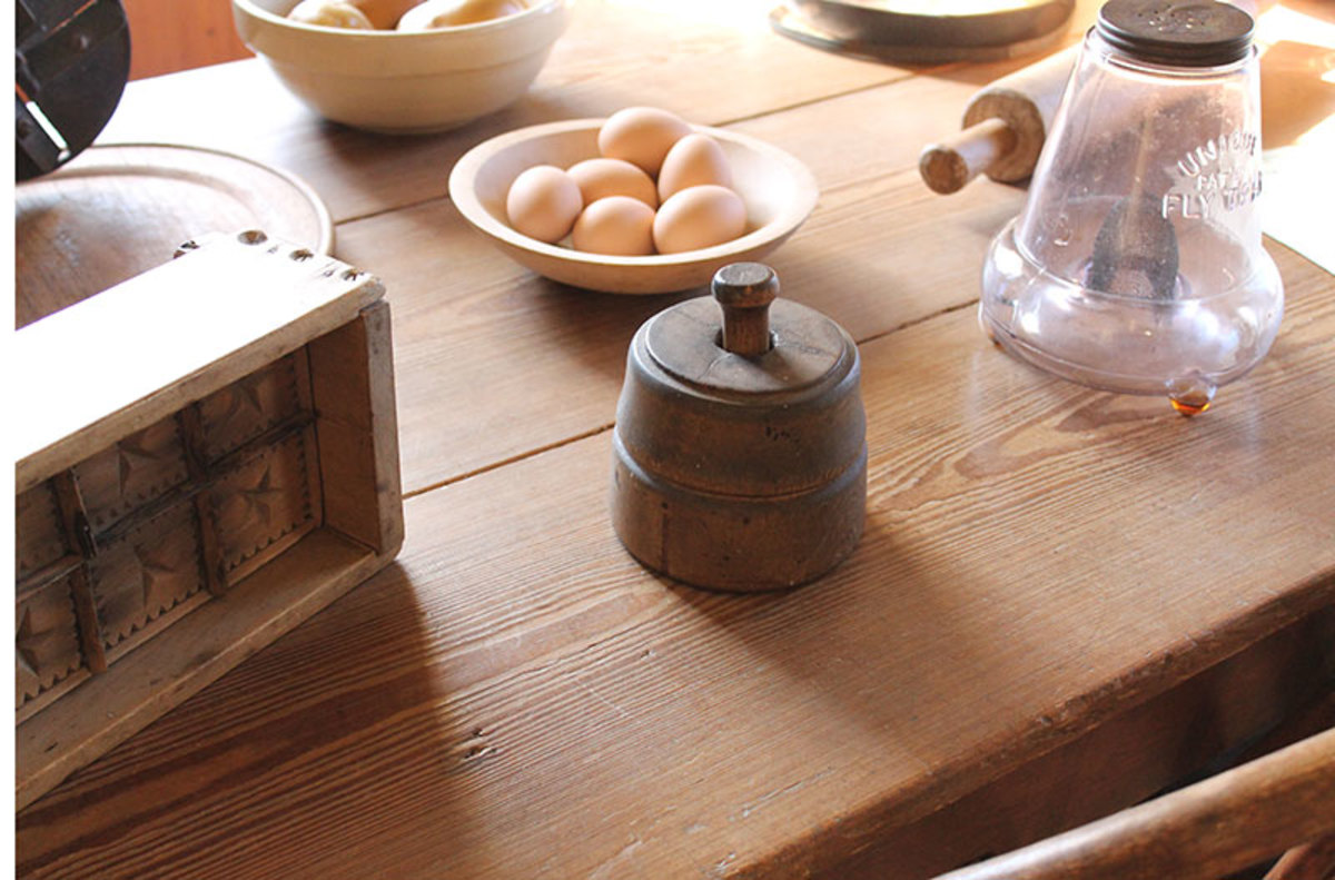 Wooden rolling pins and butter molds were common in vintage kitchens