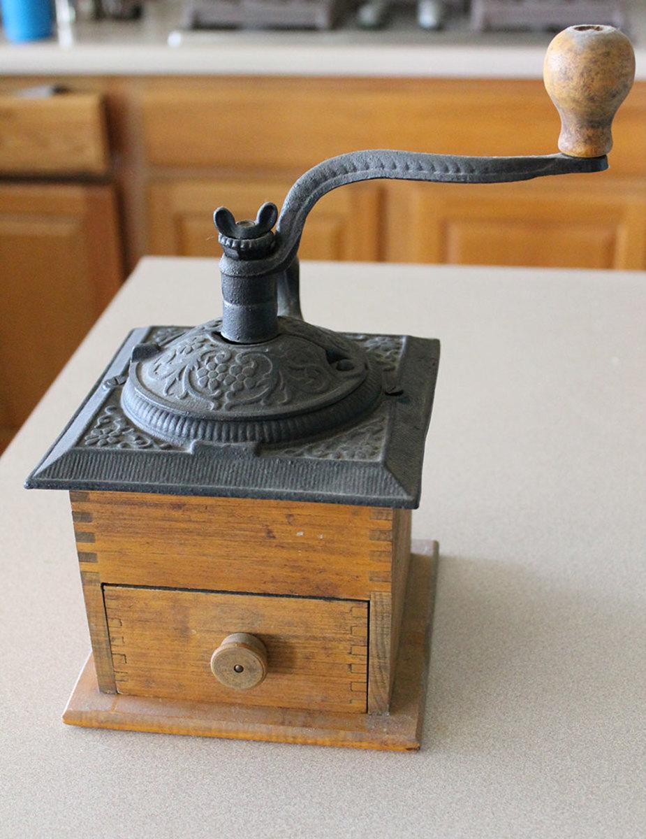 Wooden base coffee grinder