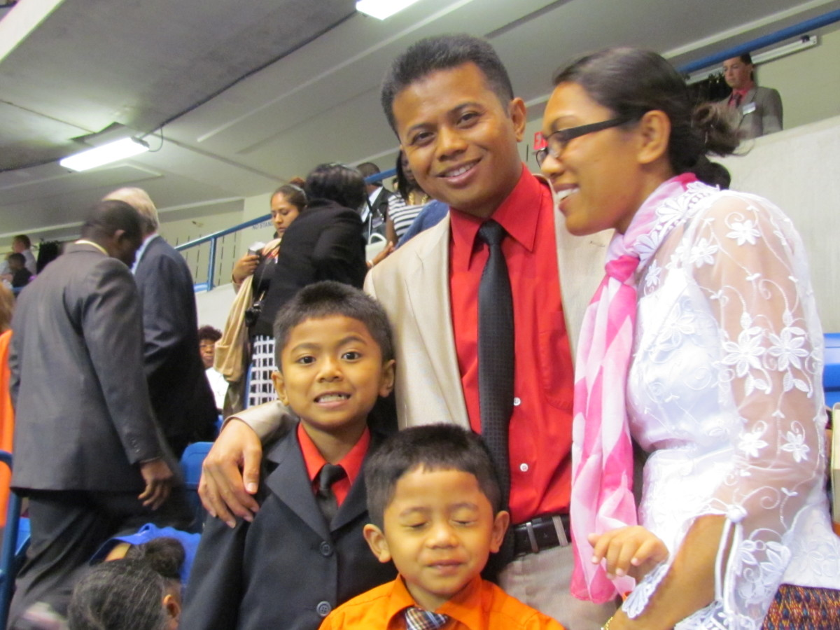 Sary Sok and Pon Nouv and their children, were beaming with smiles after the convention. They are members of the Cambodian congregation.