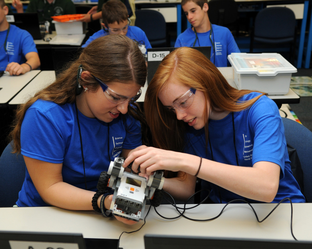 Girls learn about robotics at USNA Summer STEM.