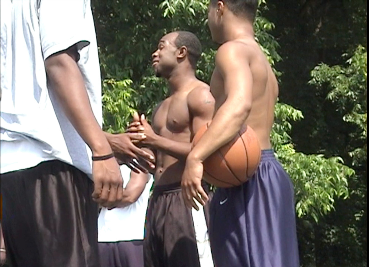 "A dispute, about the next play on the basketball court, is agreed to be settled with a ""flip""."