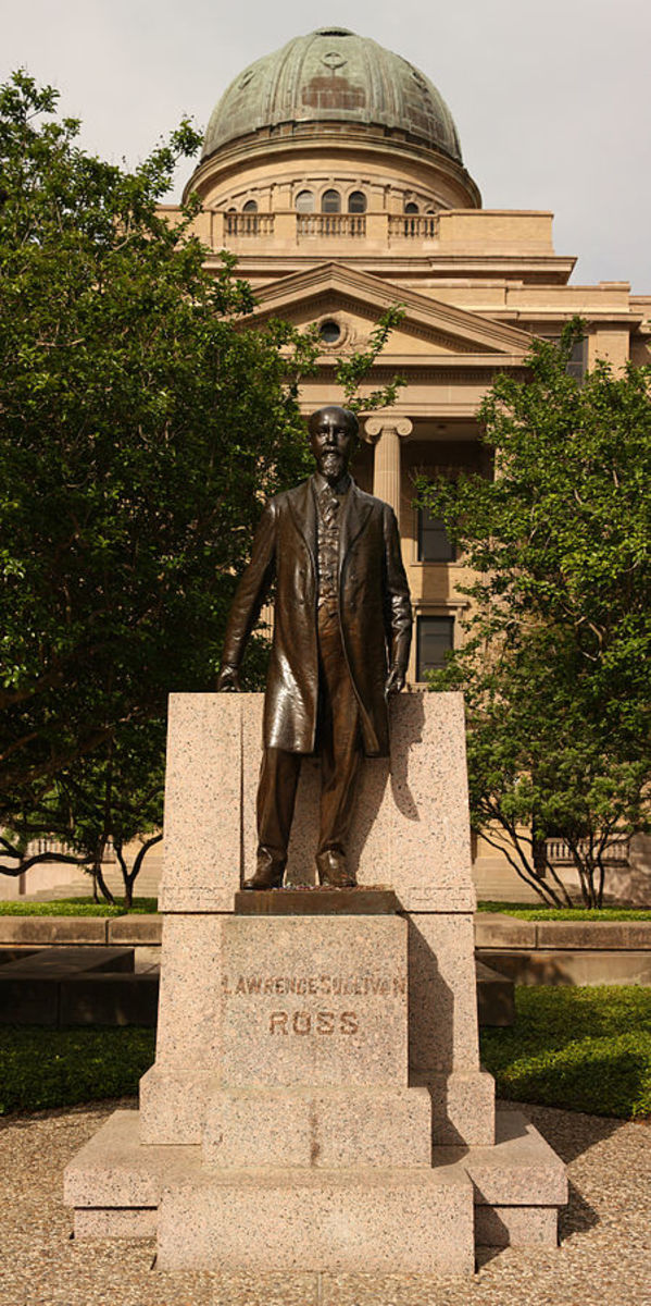 """Statue of Lawrence Sullivan """"Sul"""" Ross located in front of the Academic Building at Texas A&M."""