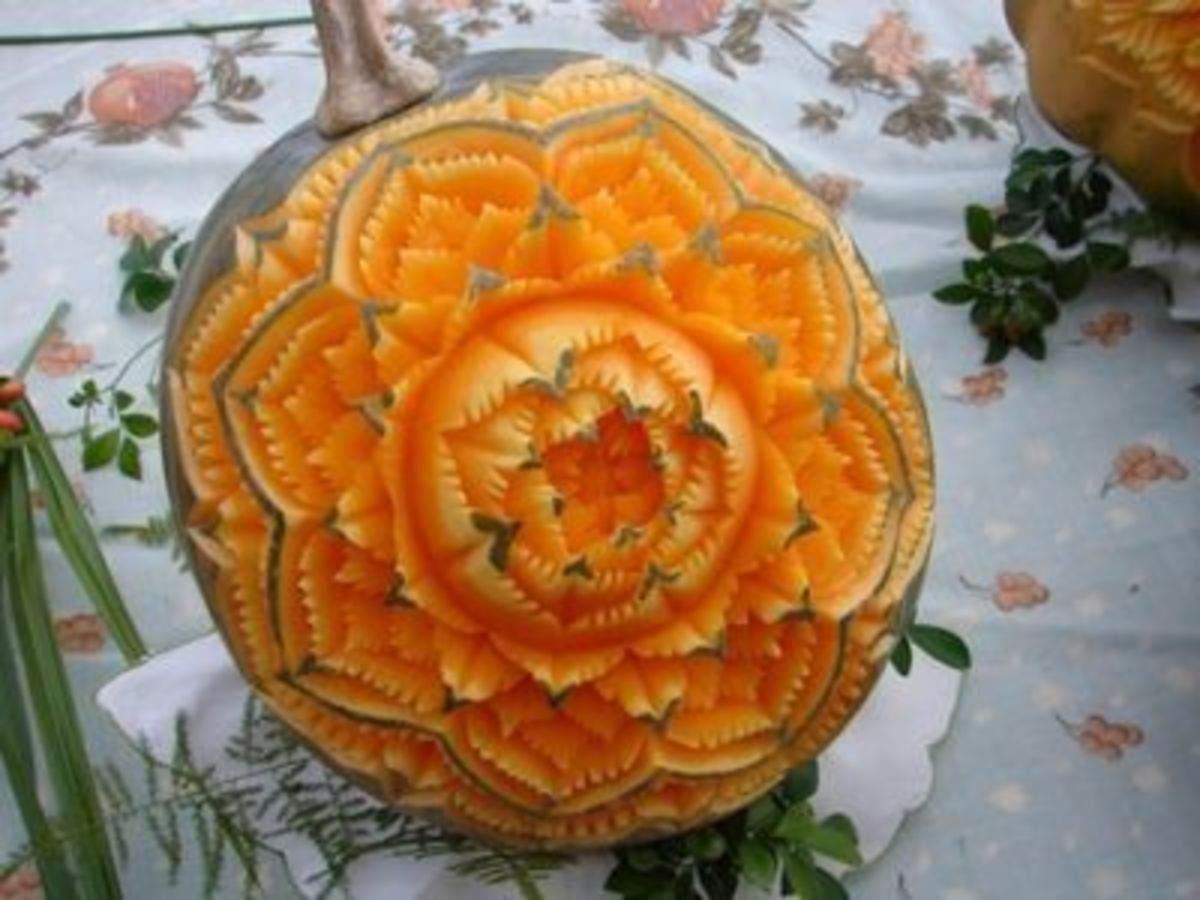 This pumpkin isn't a jack-o-lantern, but it is such a lovely carving I had to include it. This photo was shared on Flickr.