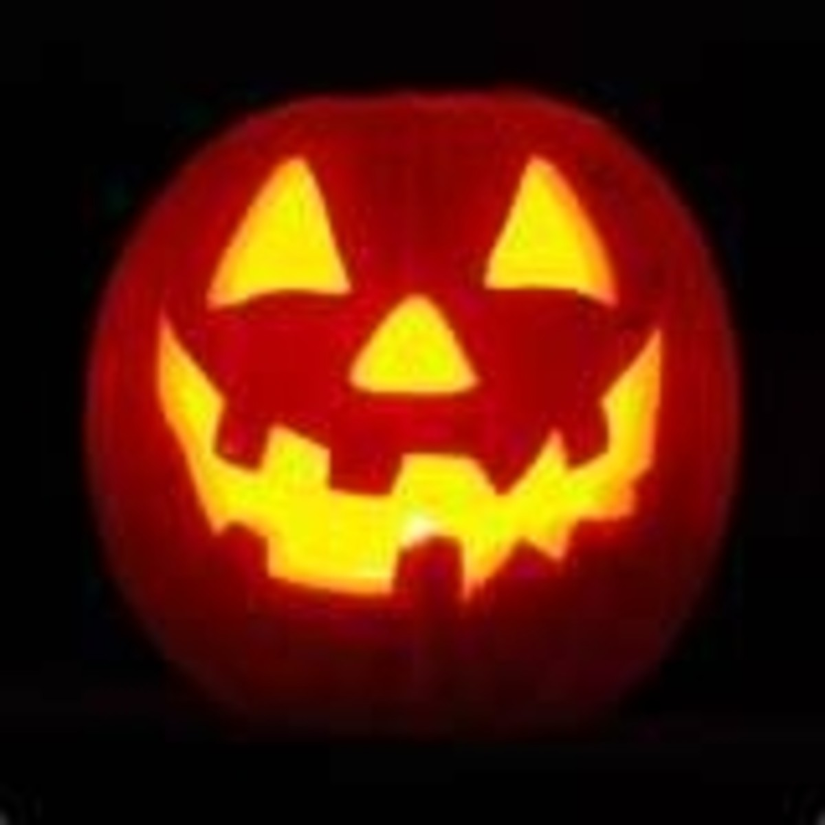 Another classic jack-o-lantern with triangular eyes and nose and toothy grin. Photo was shared on Flickr.