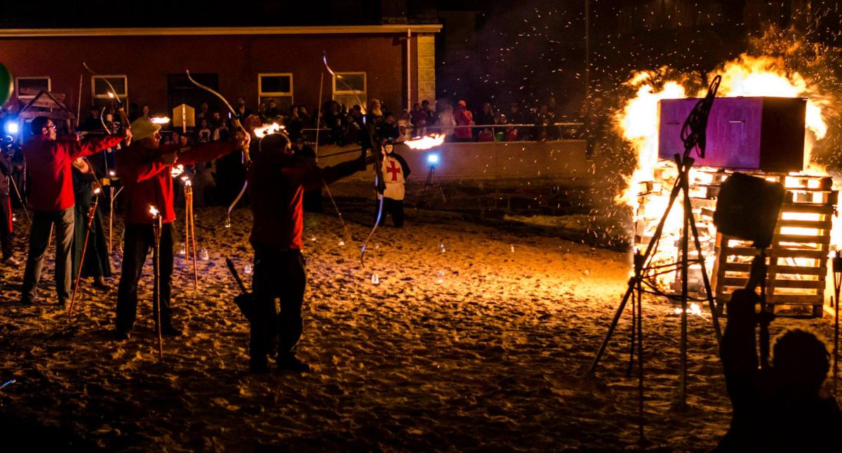 Archers light the funeral pyre at the Closing Ceremony, Youghal Halloween Festival 2014