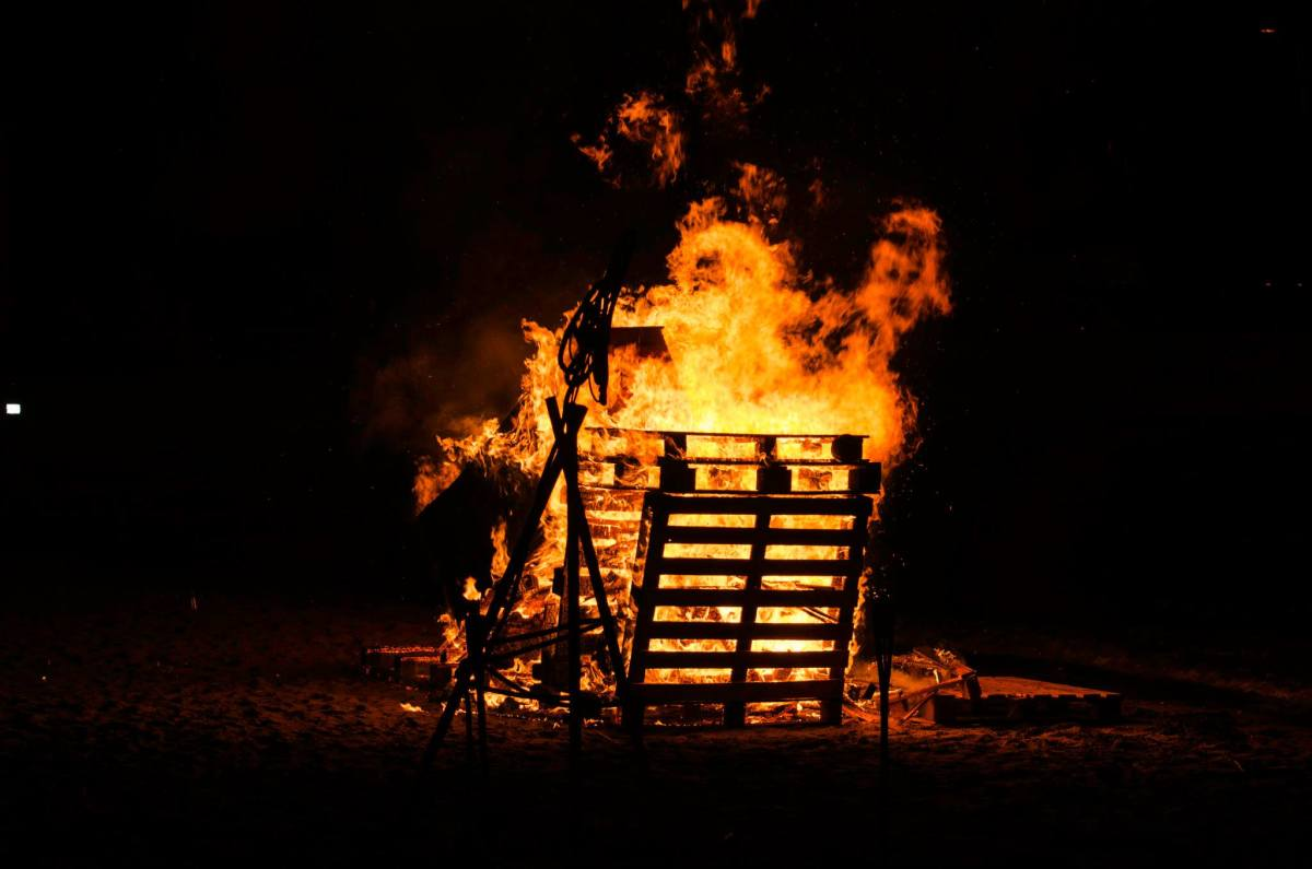 The Pyre Alight, with fire spirits in the flames