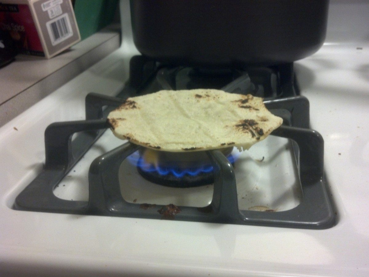 To cook corn tortillas, simply place over a clean gas burner and cook until charred in a few places. It may sound crazy, but it works.