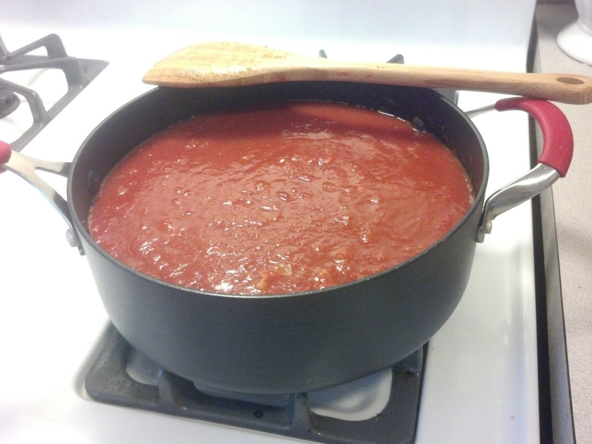Add the pureed tomatoes and simmer the sauce for 2-3 hours, making sure to stir, taste, and season frequently.