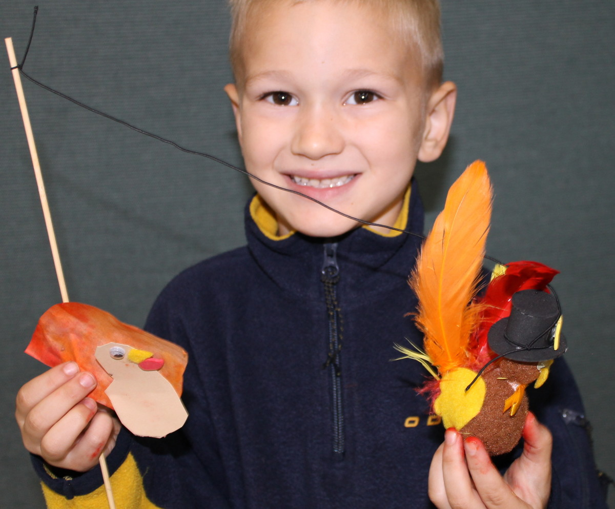 As students finish their projects, take photos of them with their Thanksgiving turkey crafts.