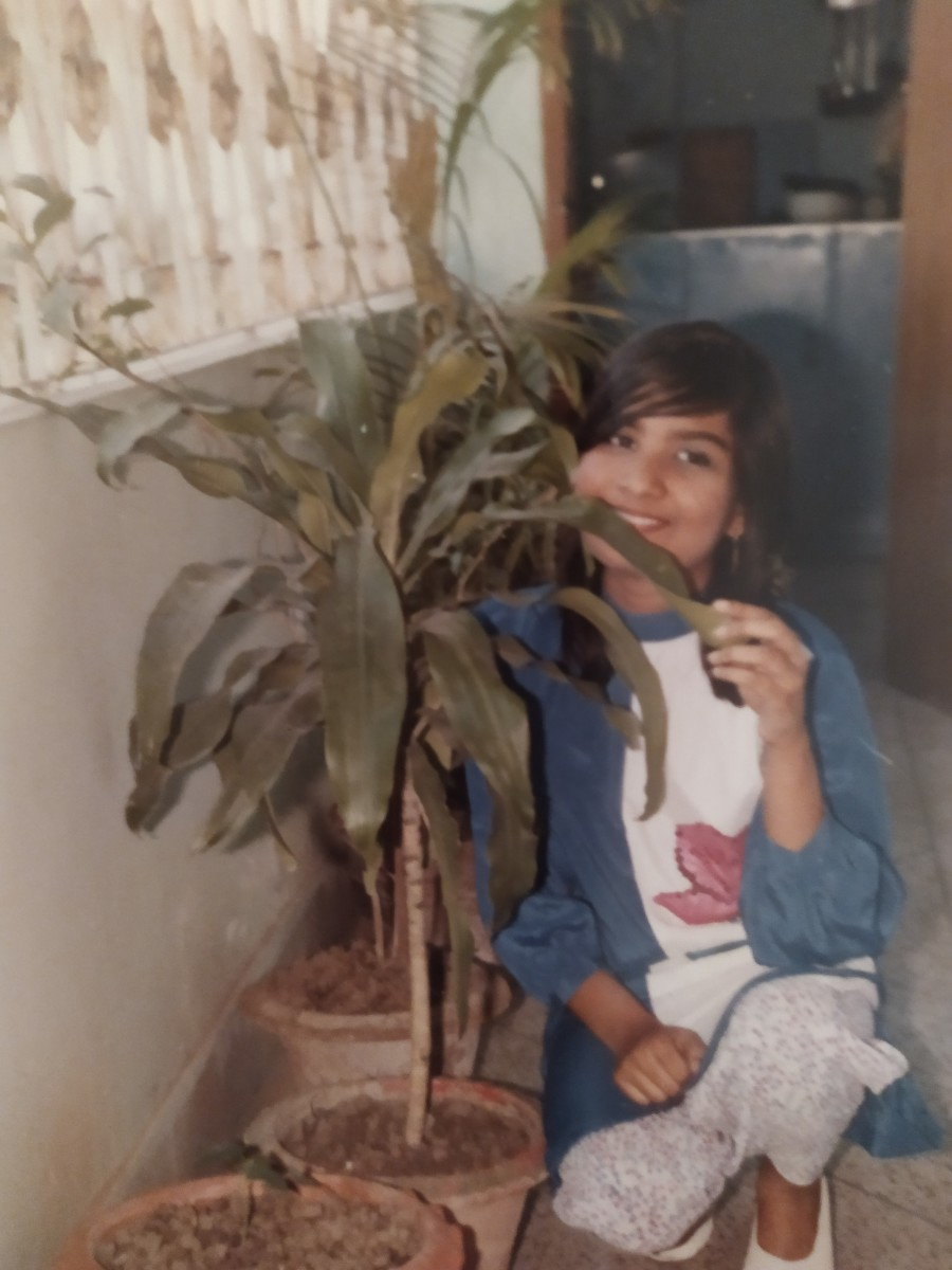 Pic15: As a Growing Teenager, I Pose near a Tub Plant of Our Balcony