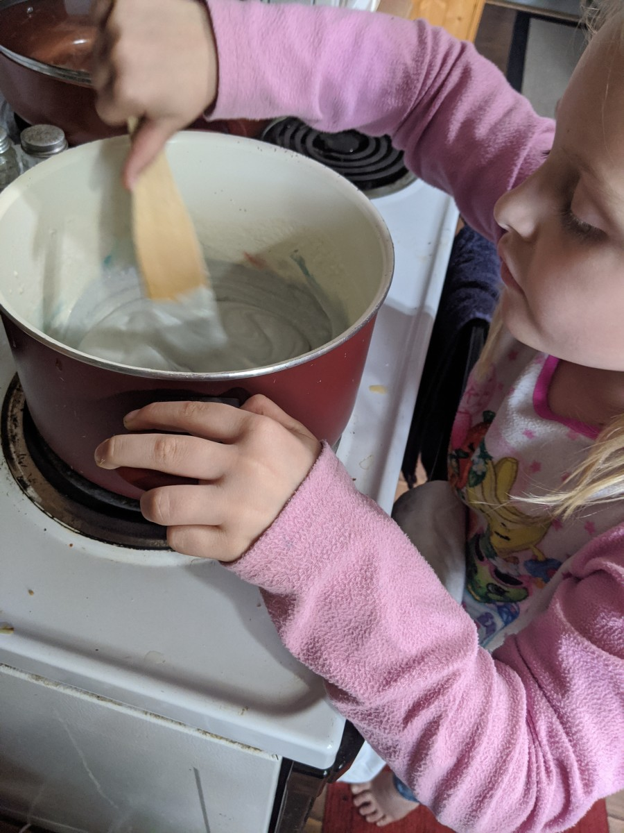 Granddaughters take turns stirring