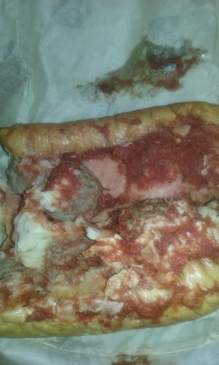 Served at Marco's Pizza Restaurant : Richly flavored meatball sandwich with tomato sauce & lots of cheese.