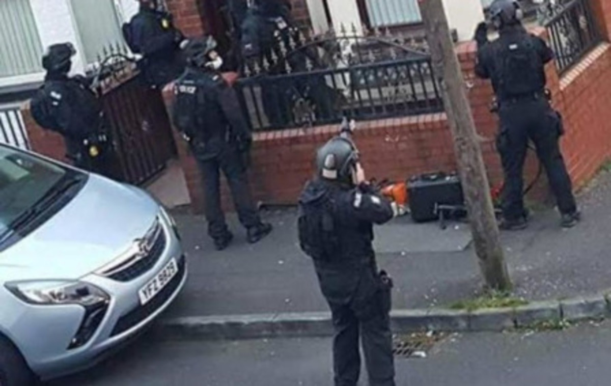 A heavily armed MI5-tasked RUC TSG gang raiding a member's home, terrifying their very young children