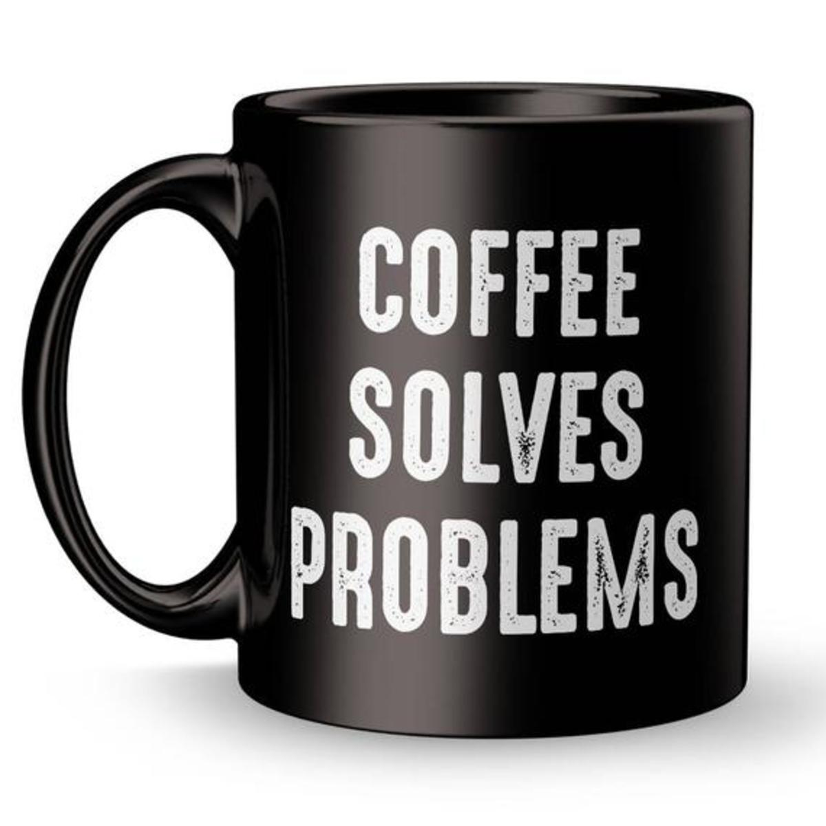 """Picture of a """"Coffee solves problems"""" mug"""