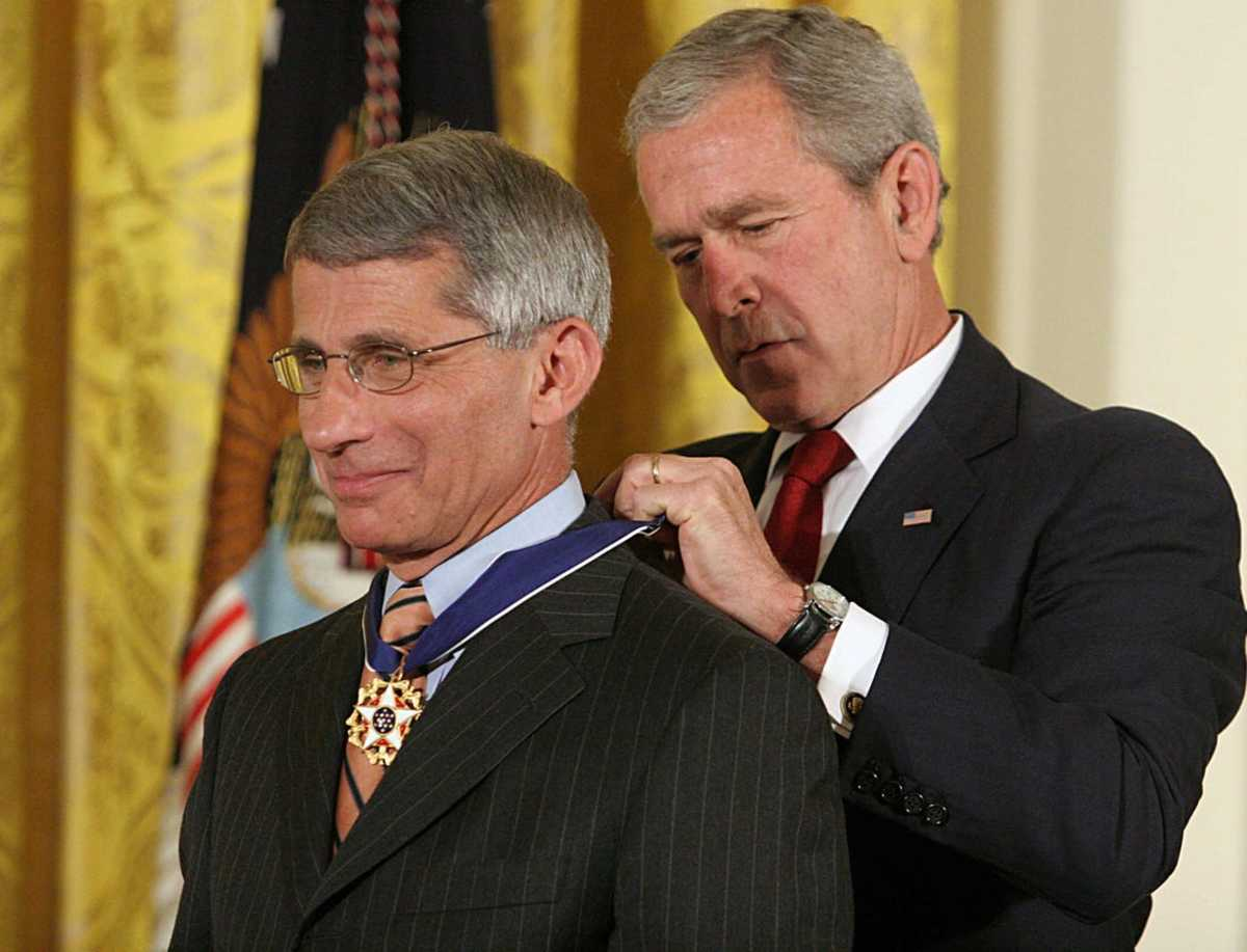 Dr. Anthony Fauci receives the Medal of Freedom Award from President George W. Bush