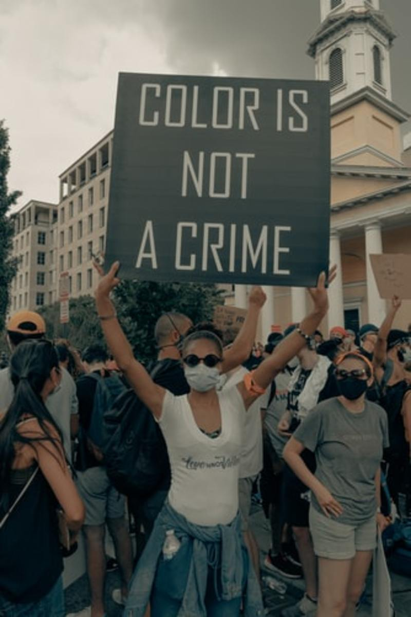 Woman holds up sign at the Black Lives Matter protest in Washington DC 6/6/2020 (IG: @clay.banks)