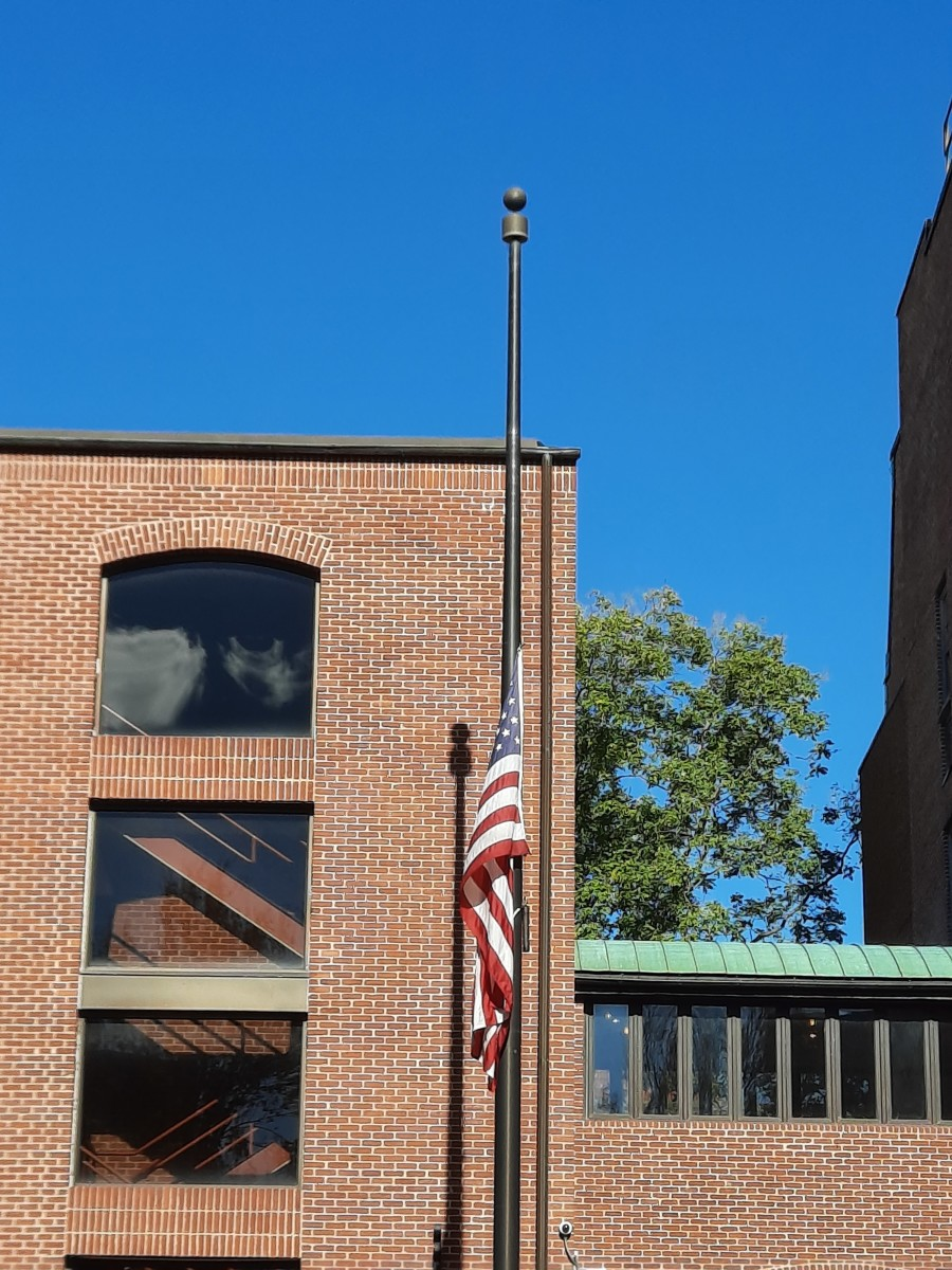 Half-staff flag for COVID victims inside Steinman Park, Lancaster, PA.